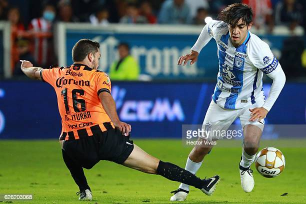 Rodolfo Pizarro of Pachuca struggles for the ball with Manuel Iturra of Necaxa during the quarter finals second leg match between Pachuca and Necaxa...