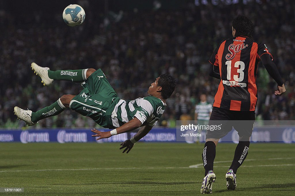 Rodolfo Salinas of Santos struggles for the ball with Jorge Rodriguez of Jaguares during a match between Santos v Jaguares at the Clausura Tournament...