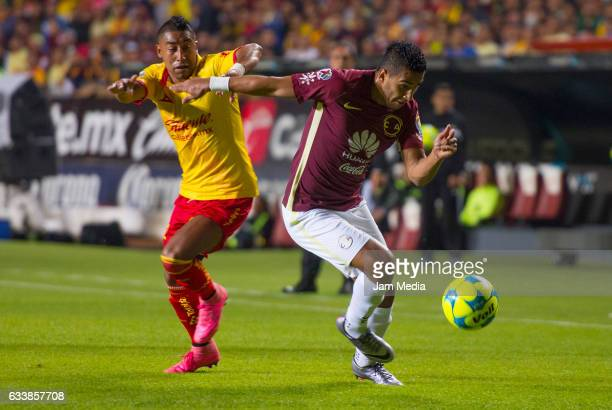 Rodolfo Vilchis of Morelia and Osvaldo Martinez of America fight for the ball during the 5th round match between Morelia and America as part of the...