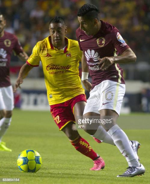 Rodolfo Vilchis of Morelia vies for the ball with Cecilio Dominguez of America during their Mexican Clausura 2017 Tournament football match at the...