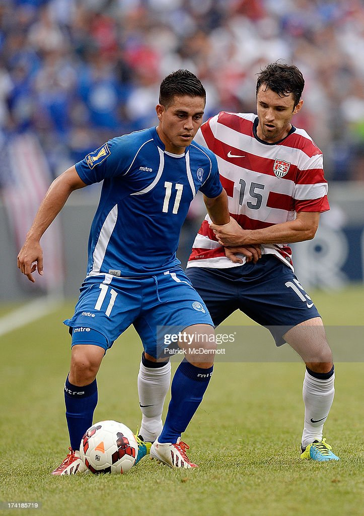 Rodolfo Zelaya Garcia #11 of El Salvador battles for the ball against Michael Parkhurst #15 of the United States in the first half during the 2013 CONCACAF Gold Cup quarterfinal game at M&T Bank Stadium on July 21, 2013 in Baltimore, Maryland.
