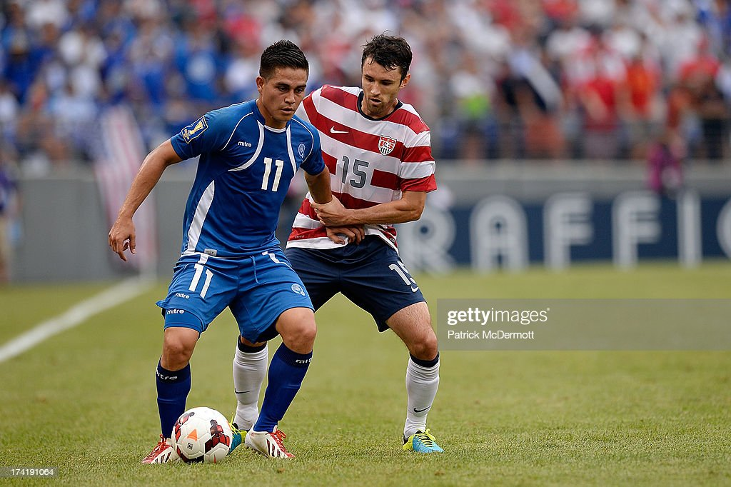 Rodolfo Zelaya Garcia #11 of El Salvador battles for the ball against Michael Parkhurst #15 of the United States during the 2013 CONCACAF Gold Cup quarterfinal game at M&T Bank Stadium on July 21, 2013 in Baltimore, Maryland.