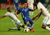 Rodolfo Zelaya Garcia of EL Salvador fights for a loose ball with Jose Velasquez Colon of Honduras during a CONCACAF Gold Cup game at Sun Life...