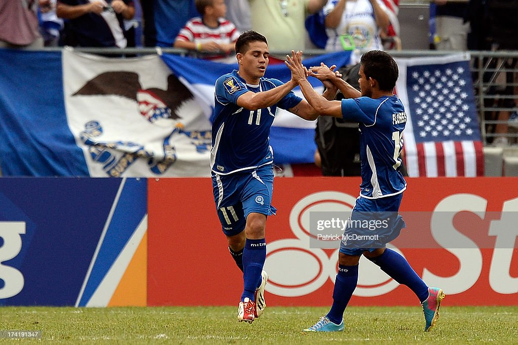 Rodolfo Zelaya #11 of El Salvador celebrates with Andres Flores #12 after scoring a goal on a penalty kick in the first half against the United States during the 2013 CONCACAF Gold Cup quarterfinal game at M&T Bank Stadium on July 21, 2013 in Baltimore, Maryland.