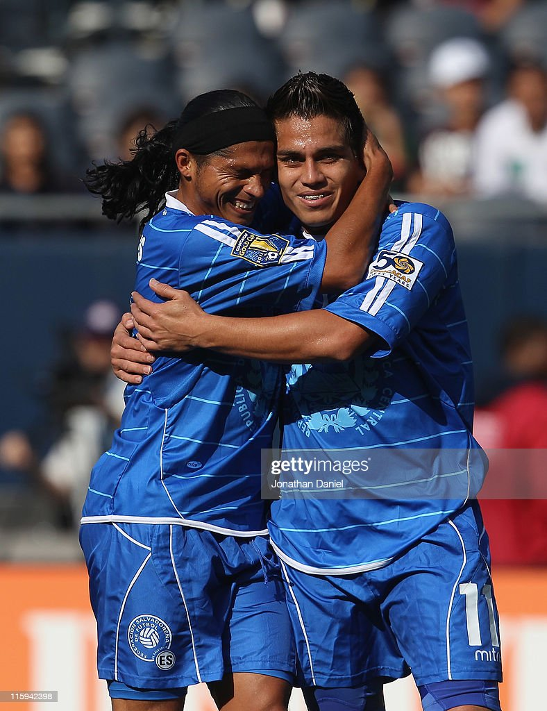 Rodolfo Zelaya of El Salvador gets a hug from teammate Rudis Corrales after scoring a goal against Cuba during a CONCACAF Gold Cup 2011 match at...