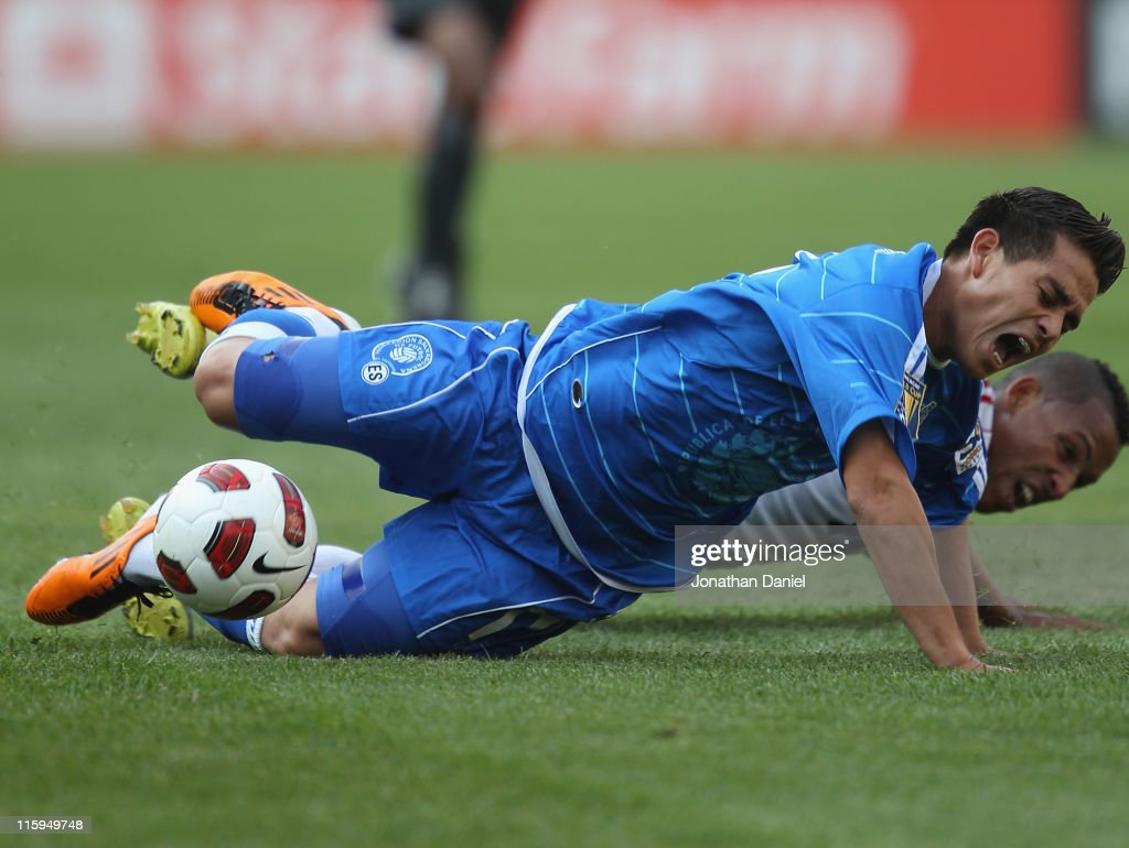 Rodolfo Zelaya of El Salvador hits the ground after being tripped by Relsandry Fernandez of Cuba during a CONCACAF Gold Cup 2011 match at Soldier...