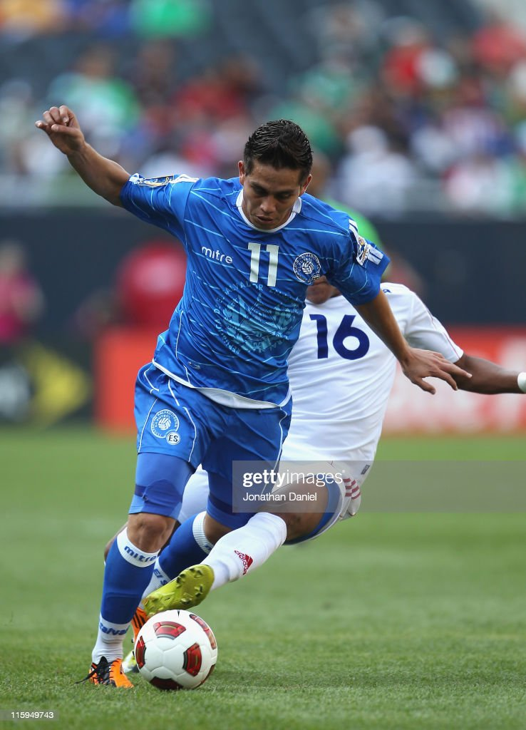 Rodolfo Zelaya of El Salvador is tripped by Relsandry Fernandez of Cuba during a CONCACAF Gold Cup 2011 match at Soldier Field on June 12 2011 in...