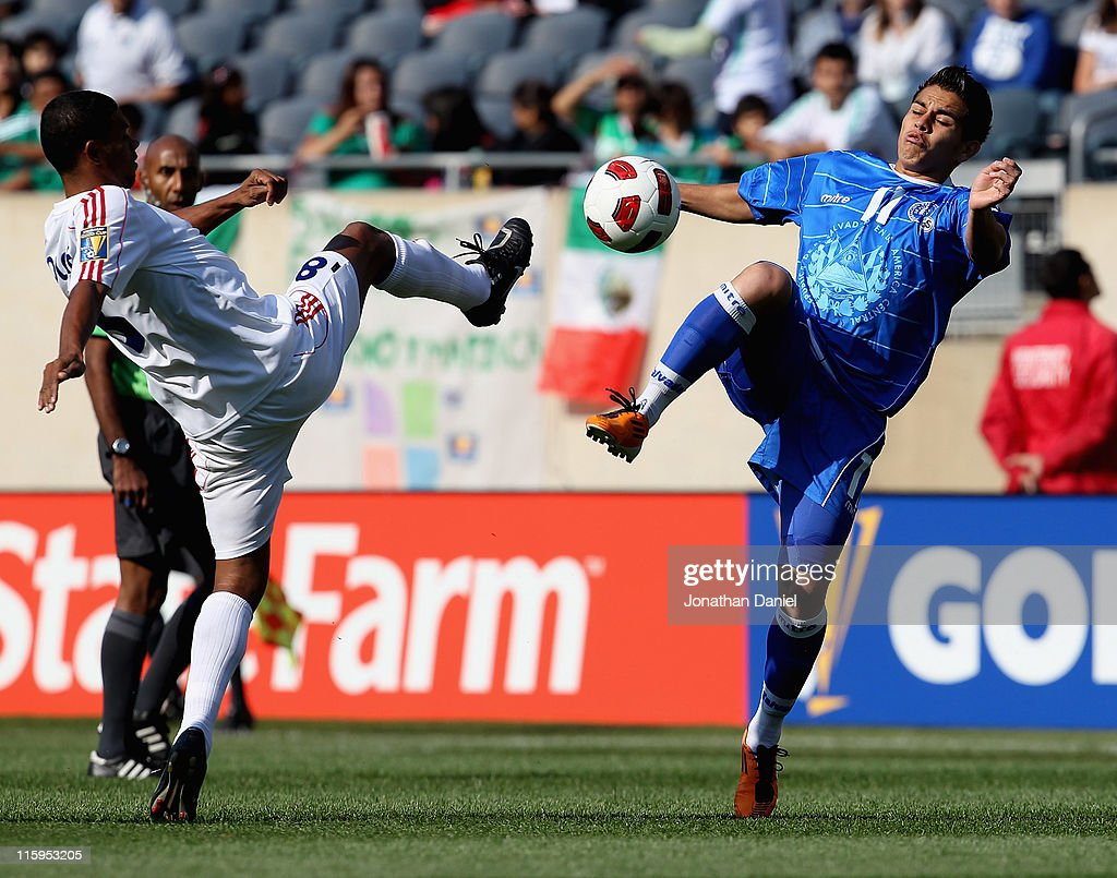 Rodolfo Zelaya of El Salvador kicks the ball away from Jaine Colome of Cuba during a CONCACAF Gold Cup 2011 match at Soldier Field on June 12 2011 in...