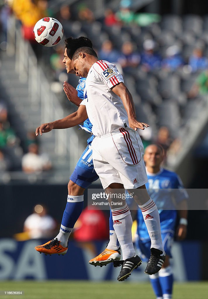 Rodolfo Zelaya of El Salvadorand Hanier Dranguet of Cuba battle for a header during a CONCACAF Gold Cup 2011 match at Soldier Field on June 12 2011...
