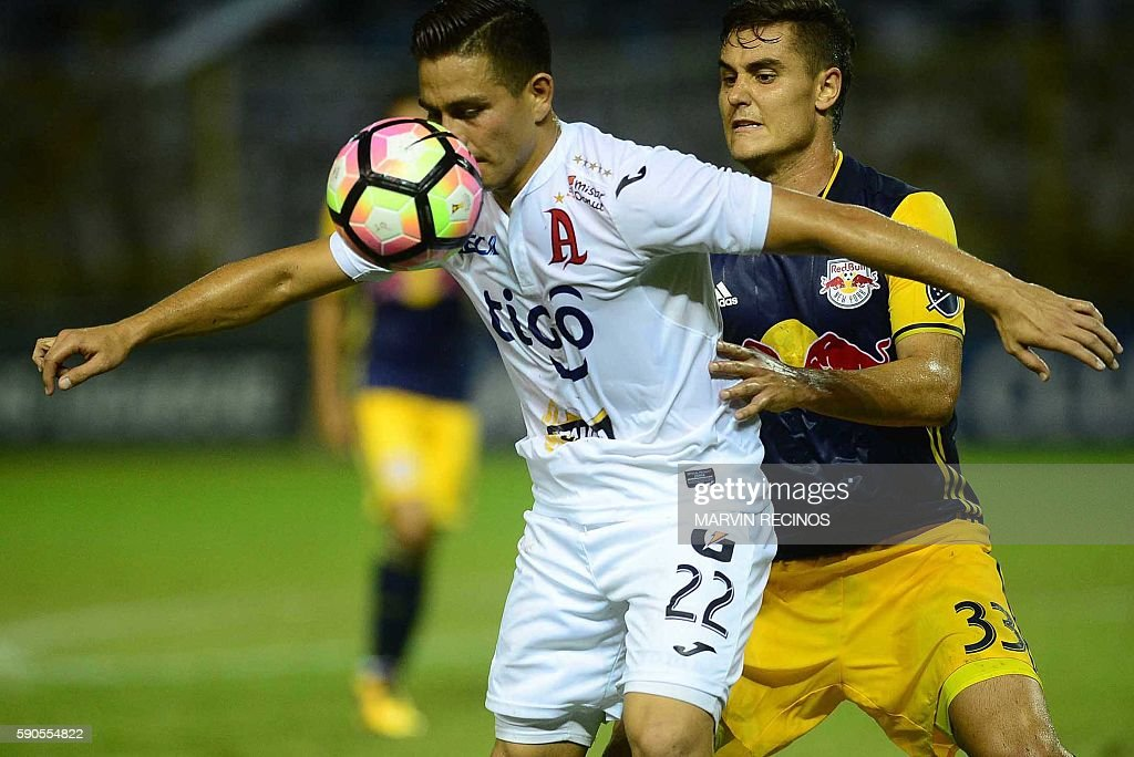 Rodolfo Zelaya of Salvadorean team Alianza F C fights for the ball with Aaron Long of New York Red Bulls during a CONCACAF Champions League football...