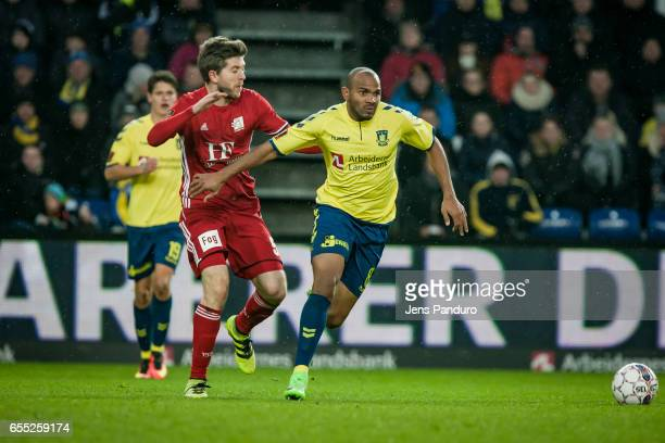 Rodolph Austin of Brondby IF and a Lyngby player the Danish Alka Superliga match between Brondby IF and Lyngby BK at Brondby Stadion on March 19 2017...