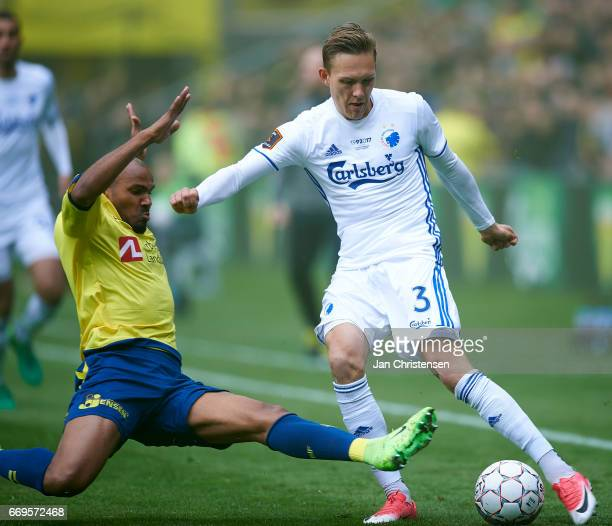 Rodolph Austin of Brondby IF and Ludwig Augustinsson of FC Copenhagen compete for the ball during the Danish Alka Superliga match between Brondby IF...
