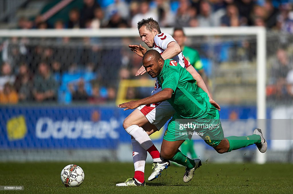 Rodolph Austin of Brondby IF and Thomas Enevoldsen of AaB Aalborg compete for the ball during the Danish Alka Superliga match between AaB Aalborg and Brondby IF at Nordjyske Arena on May 1, 2016 in Aalborg, Denmark.