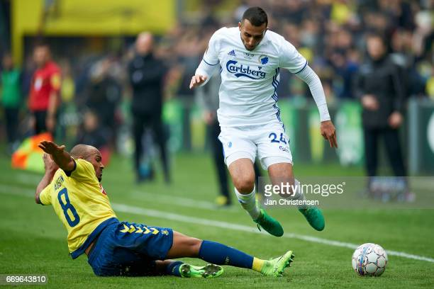 Rodolph Austin of Brondby IF and Youssef Toutouh of FC Copenhagen compete for the ball during the Danish Alka Superliga match between Brondby IF and...