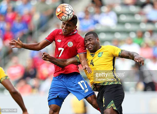 Rodolph Austin of Costa Rica jumps to head the ball against Westley Morgan of Jamaica in their CONCACAF Gold Cup Group B match at StubHub Center on...