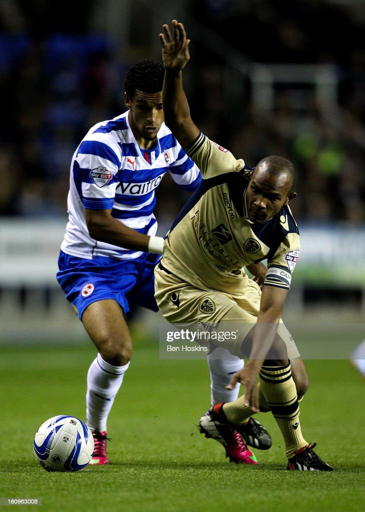 Rodolph Austin of Leeds holds off the challenge of Nick Blackman of Reading during the Sky Bet Championship match between Reading and Leeds United at Madejski Stadium on September 18, 2013 in Reading, England.