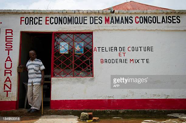 Rodolphe Malala leaves the workshop of a notforprofit organisation to help Congolese women that he helped to create in Lubumbashi on December 5 2011...