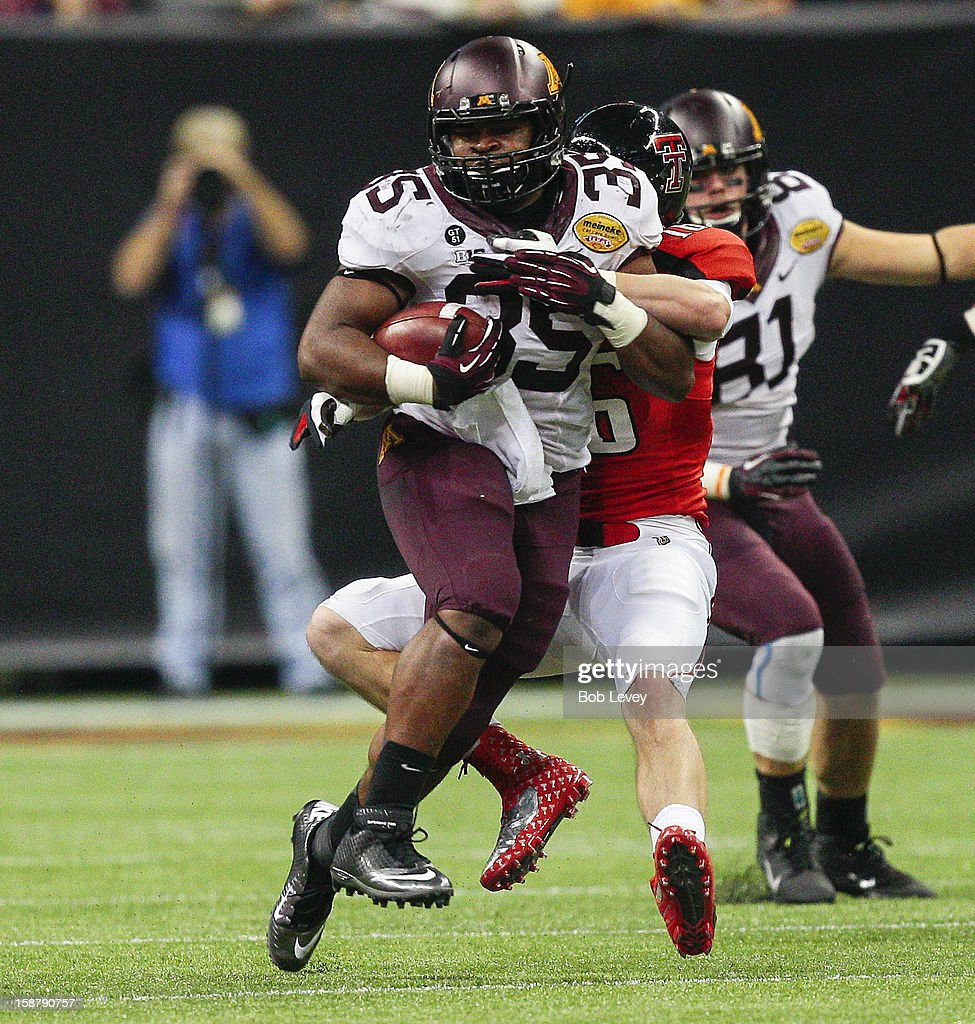 Rodrick Williams Jr. #35 of the Minnesota Golden Gophers rushed against the Texas Tech Red Raiders during the Meineke Car Care of Texas Bowl at Reliant Stadium on December 28, 2012 in Houston, Texas. Texas Tech defeated Minnesota 34-31.