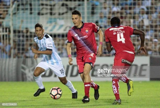 Rodrigo Aliendo of Argentinian Atletico Tucuman vies for the ball with Jonathan Borja of Ecuadorean El Nacional during a Copa Libertadores football...