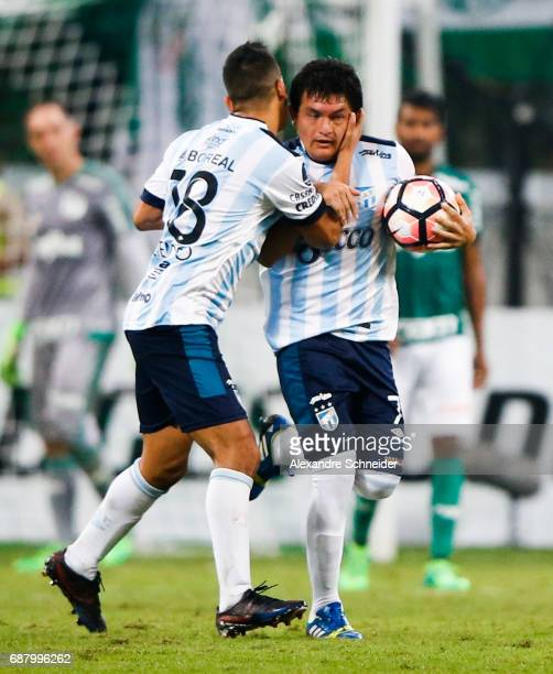 Rodrigo Aliendro and Luis Rodriguez of Atletico Tucuman of Argentina celebrate their first goal during the match between Palmeiras and Atletico...