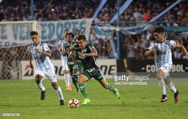 Rodrigo Aliendro of Argentina's Atletico Tucuman vies for the ball with Dudu of Brazil's Palmeiras during their Copa Libertadores football match in...