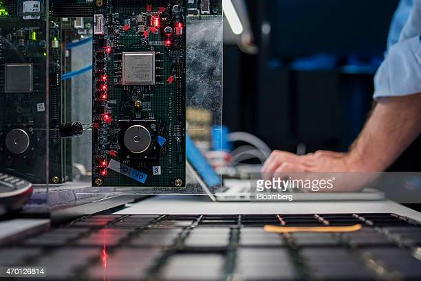 Rodrigo Alverez system engineer for International Business Machines Corp tests new SyNAPSE chips at the IBM Almaden Research Center in San Jose...