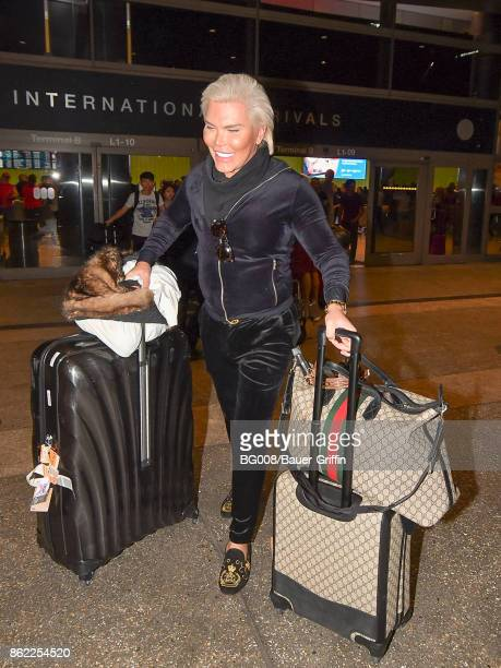 Rodrigo Alves aka 'Human Ken Doll' is seen at Los Angeles International Airport on October 16 2017 in Los Angeles California