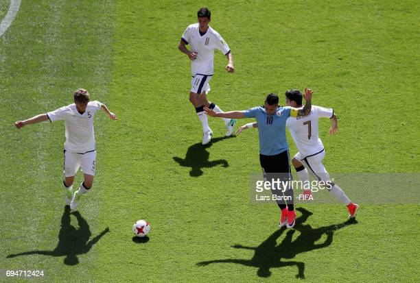 Rodrigo Amaral of Uruguay is challenged by Riccardo Orsolini of Italy during the FIFA U20 World Cup Korea Republic 2017 3rd rank playoff match...