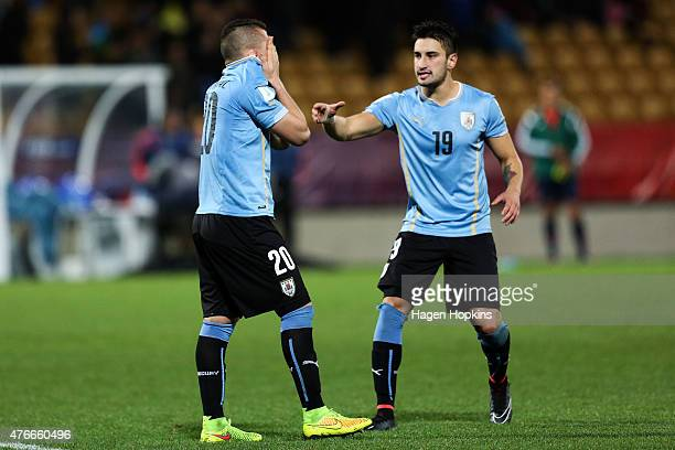 Rodrigo Amaral of Uruguay is consoled by teammate Erick Cabaco after failing to score in a penalty shootout during the FIFA U20 World Cup New Zealand...