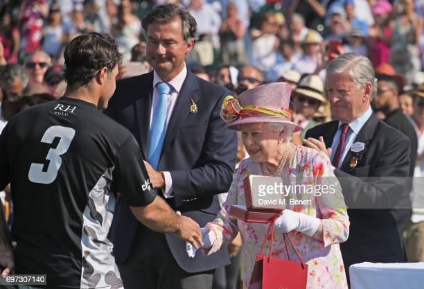 Rodrigo Andrade Laurent Feniou Queen Elizabeth II and Jock GreenArmytage attend the Cartier Queen's Cup Polo final at Guards Polo Club on June 18...