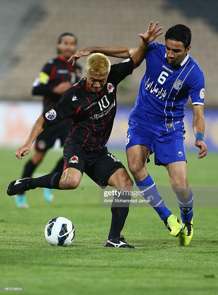 Rodrigo Barbosa of Al Rayyan and Javad Nekounam of Esteghlal in action during the AFC Champions League Group D match between Esteghlal and Al Rayyan at Azadi Stadium on April 23, 2013 in Tehran, Iran.