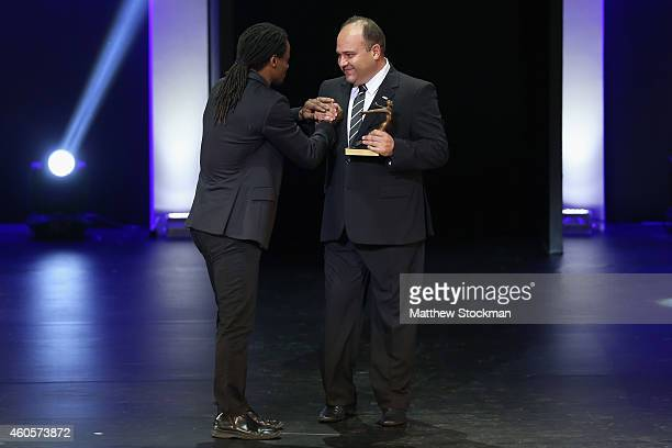 Rodrigo Bastos is presented with the Shooting Athlete of the Year Trophy during the Brazil Olympics Awards Ceremony at Theatro Municipal on December...