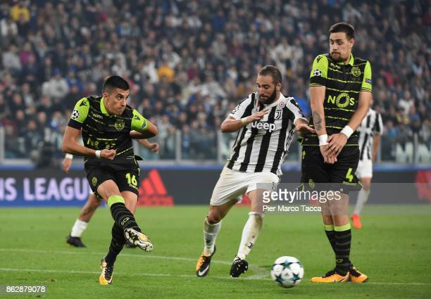 Rodrigo Battaglia of Sporting CP shoots the ball during the UEFA Champions League group D match between Juventus and Sporting CP at Juventus Stadium...