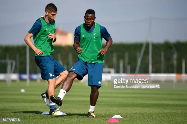Rodrigo Bentancur and Kwadwo Asamoah of Juventus during the afternoon training session on July 11 2017 in Vinovo Italy
