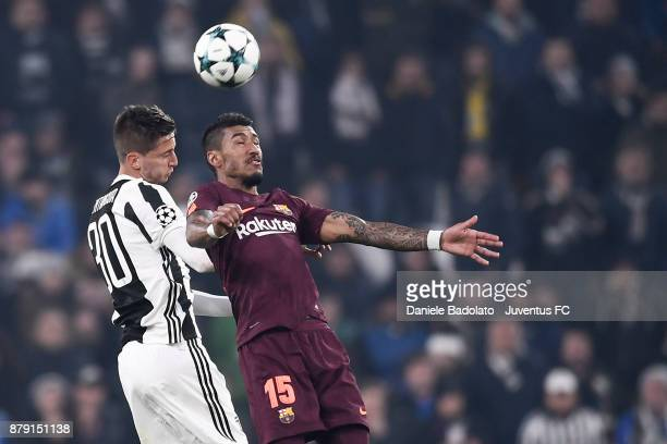 Rodrigo Bentancur and Paulinho during the UEFA Champions League group D match between Juventus and FC Barcelona at Allianz Stadium on November 22...
