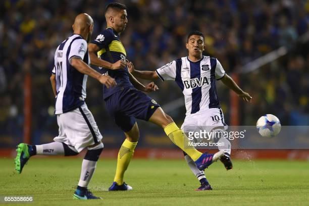 Rodrigo Bentancur of Boca Juniors fights for ball with Emanuel Reynoso and Pablo Guiñazu of Talleres during a match between Boca Juniors and Talleres...