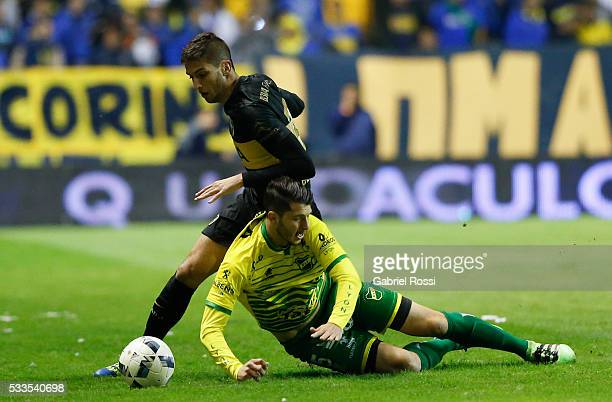 Rodrigo Bentancur of Boca Juniors fights for the ball with Guido Rodriguez of Defensa y Justicia during a match between Boca Juniors and Defensa y...