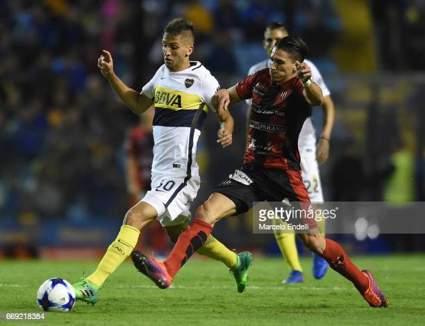 Rodrigo Bentancur of Boca Juniors fights for the ball with Marcelo Guzman of Patronato during a match between Boca Juniors and Patronato as part of...