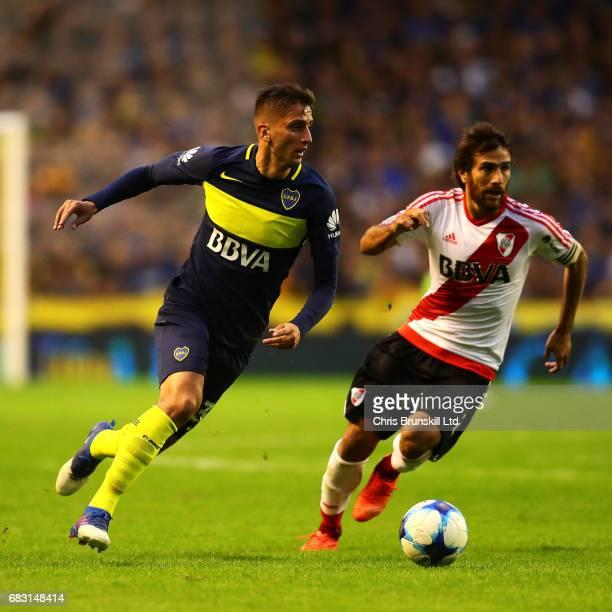 Rodrigo Bentancur of Boca Juniors in action with Leonardo Ponzio of River Plate during the Torneo Primera Division match between Boca Juniors and...