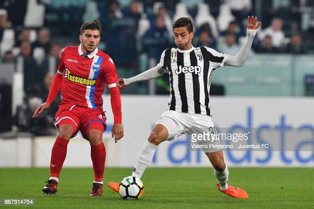 Rodrigo Bentancur of Juventus and Alberto Paloschi of Spal fight for the ball during the Serie A match between Juventus and Spal on October 25 2017...