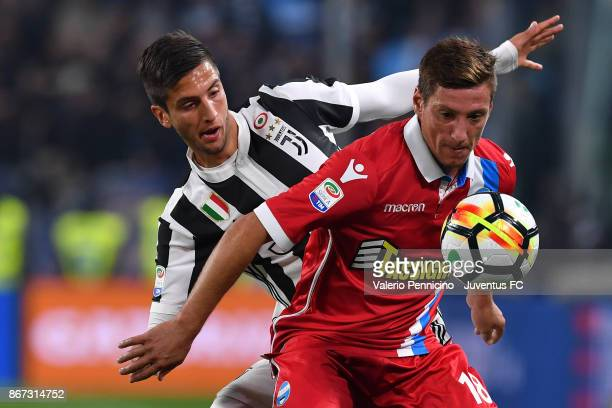 Rodrigo Bentancur of Juventus and Eros Schiavon of Spal fight for the ball during the Serie A match between Juventus and Spal on October 25 2017 in...