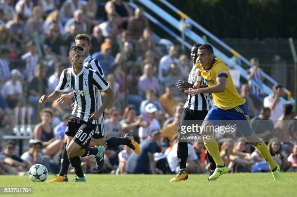 Rodrigo Bentancur of Juventus is chased by an opponent during the preseason friendly match between Juventus A and Juventus B on August 17 2017 in...