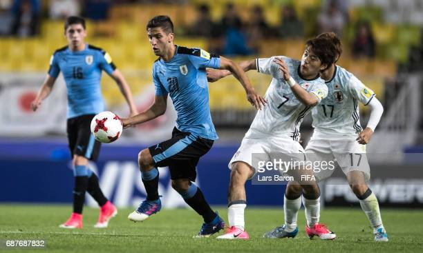 Rodrigo Bentancur of Uruguay is challenged by Ritsu Doan of Japan during the FIFA U20 World Cup Korea Republic 2017 group D match between Uruguay and...