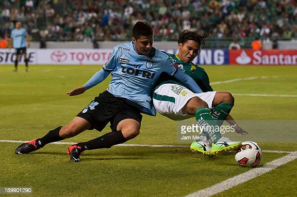 Rodrigo Brito of Deportes Iquique struggles for the ball with Carlos Pena of Leon during a match between Deportes Iquique and Leon as part of the...