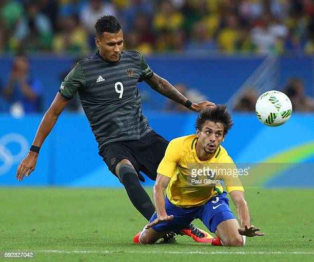 Rodrigo Caio of Brazil and Davie Selke of Germany in action during the Men's Football Final between Brazil and Germany at the Maracana Stadium on Day...