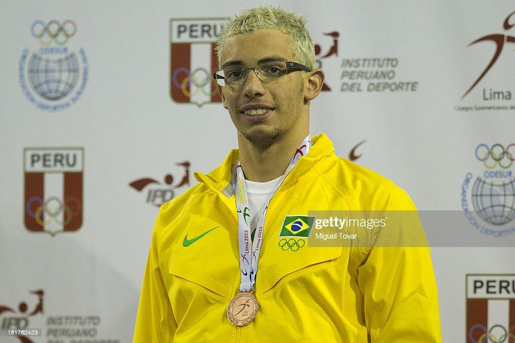 Rodrigo Codo of Brazil receives the bronze medal in men's 50 meter Breatstroke as part of the I ODESUR South American Youth Games at Piscina Ol'mpica Campo de Marte on September 24, 2013 in Lima, Peru.