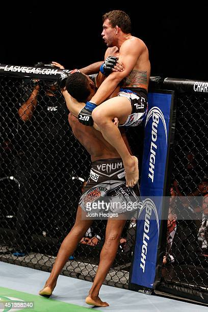 Rodrigo de Lima attempts to secure a triangle choke submission against Neil Magny in their welterweight fight during the UFC Fight Night event at...