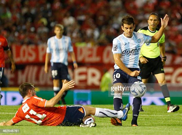 Rodrigo de Paul of Racing Club and Federico Mancuello of Independiente fight for the ball during a match between Racing Club and Independiente as...