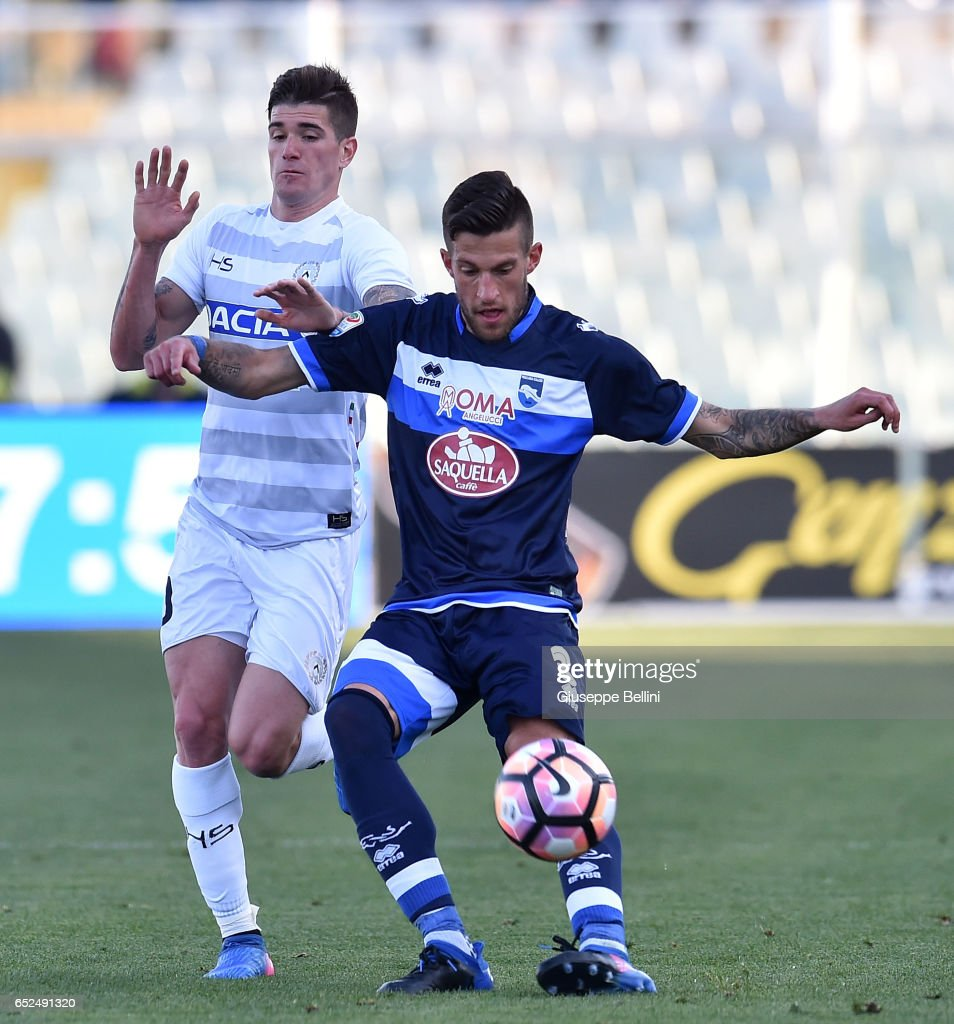 Rodrigo De Paul of Udinese Calcio and Cristiano Biraghi of Pescara Calcio in action during the Serie A match between Pescara Calcio and Udinese Calcio at Adriatico Stadium on March 12, 2017 in Pescara, Italy.