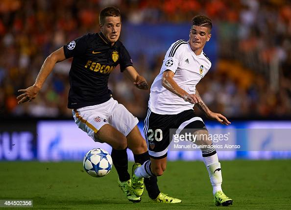 Rodrigo De Paul of Valencia battle for the ball with Mario Pasalic of Monaco during the UEFA Champions League Qualifying Round Play Off First Leg...